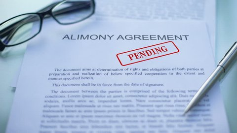 Alimony agreement pending, officials hand stamping seal on business document