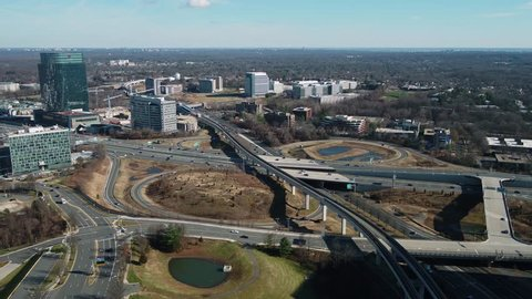 Tysons, VA / USA - December 29 2018: Aerial pan from right to left showing the Capital Beltway running through Tysons Corner with the Capital One building prominent