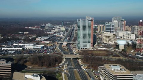 Tysons, VA / USA - December 27 2018: Slow pan from left to right starting high over Leesburg Pike and moving across Tysons to the Galleria