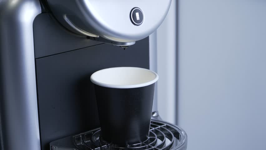 Coffee machine pours coffee