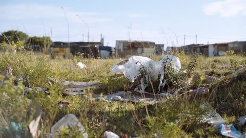 Plastic trash piling up outside an impoverished shanty town in South Africa.