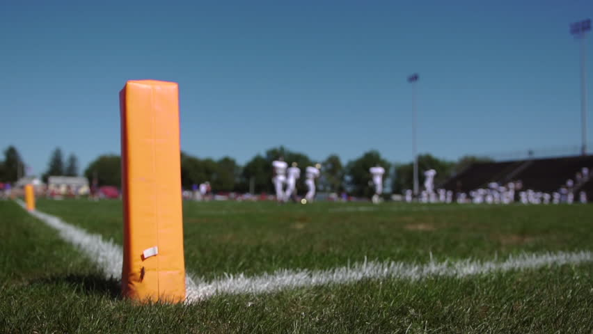 Orange pylon in the back of the end zone, during a football game  | Shutterstock HD Video #1023203125