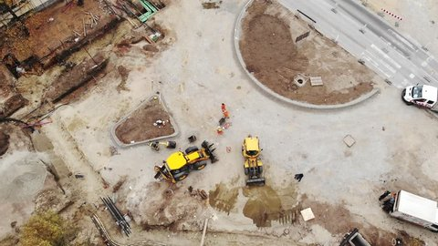 Road Roundabout Construction excavator,aerial drone view: Vojvodina, Serbia October 27 2018
