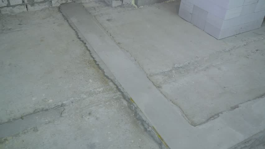 concrete basement prepared for further setting of brick wall