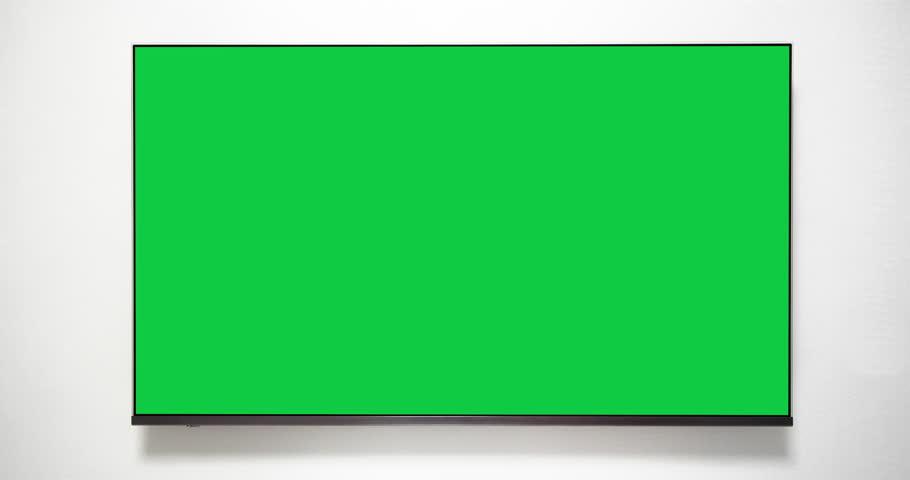 4K - Flat screen TV with green screen. Chroma key TV on white wall   Shutterstock HD Video #1023291595