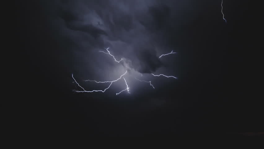 Lightning in the sky. Electric discharges in the sky. | Shutterstock HD Video #1023350845