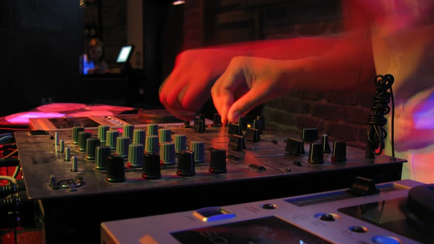 Close-up view on DJ panel during party in nightclub, time lapse