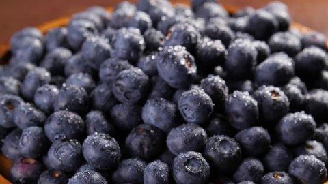 Heap of fresh blueberries rotating. Closeup macro shot. Fresh berry series. 4k.