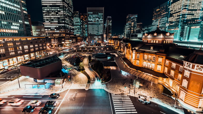 4K UHD time-lapse of car traffic at Tokyo Station at night with Japanese people crossing roads. Tokyo tourist attraction, Japan tourism, Asian city life, or Asia transportation concept | Shutterstock HD Video #1023431845