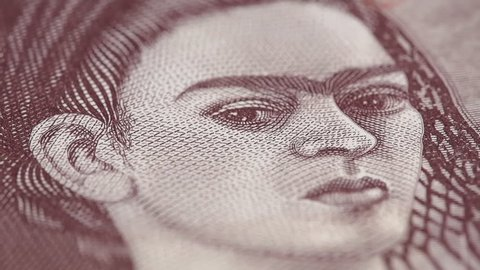 Frida Kahlo on Mexico 500 peso bill macro slow rotating. Low angle. Stock video footage.