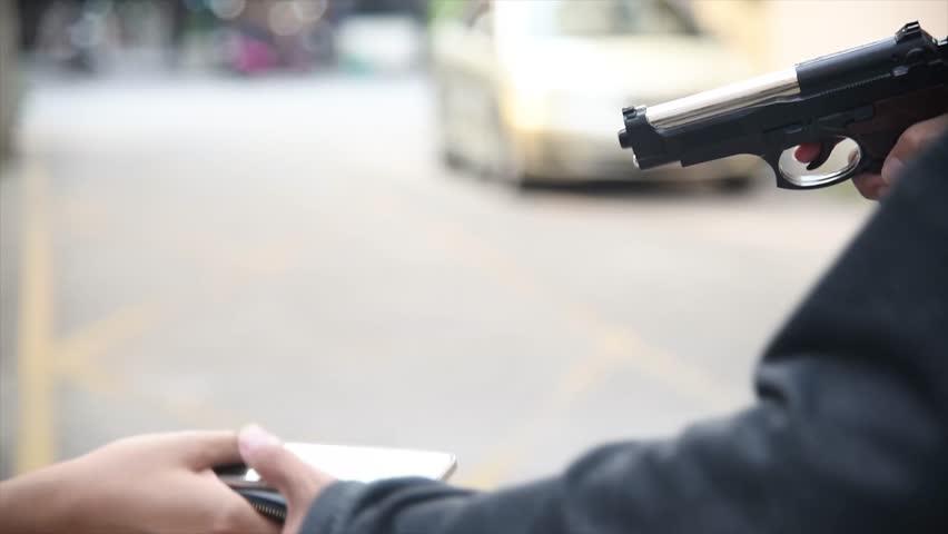 Office girl was hijacked with a gun,Steal belongings | Shutterstock HD Video #1023470215