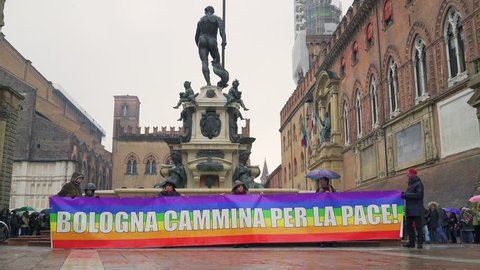 "Bologna, Italy - February 2 2019: Human chain around Piazza Maggiore and ""Bologna walks for peace"" sign against Salvini's politics about immigration."