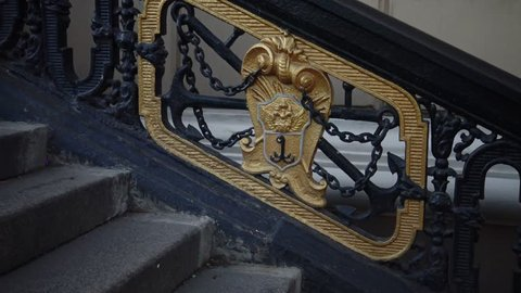 Old coat of arms of Odessa on the cast-iron stairs near the Opera and Ballet Theater