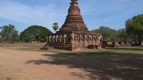 Elephant sculptures at the base of the Chedi ancient Buddhist temple Wat Sorasak. Sukhothai, Thailand
