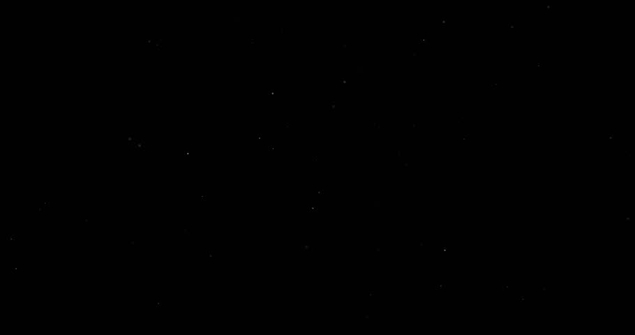 Flying dust particles on a black background | Shutterstock HD Video #1023482905