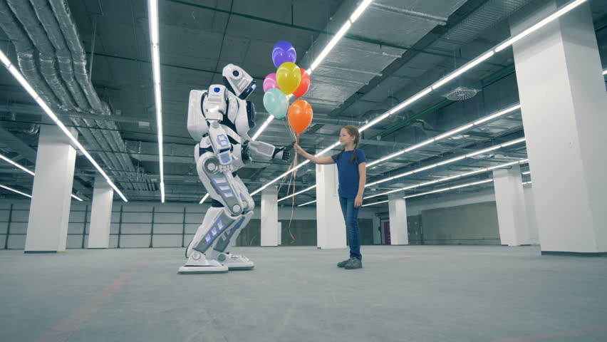 A droid gives balloons to a girl and touches her hand, close up. | Shutterstock HD Video #1023534775