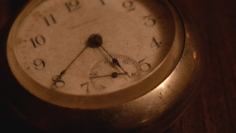Old pocket watch with second hand moving