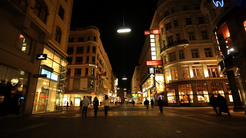 VIENNA, AUSTRIA - MARCH 1, 2009 Time Lapse Establishing Shot of Vienna People Walk Graben Shopping Street Night | Shutterstock HD Video #1023580465
