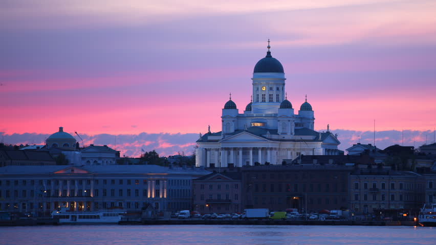 HELSINKI, FINLAND - MAY 21, 2011 Time Lapse of Helsinki Skyline Famous Cathedral and Ferry Boats Dusk to Night