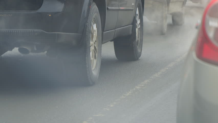 Cars in traffic. Exhaust fumes from the exhaust pipe