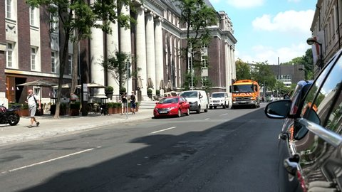 Dusseldorf, Germany - July 28, 2018: Street sweeper cleaning vehicle in the central part of the city