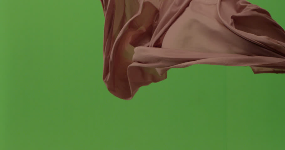 Abstract material floating cloth fabric against green screen in slow motion    Shutterstock HD Video #1023831325