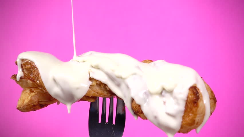 White chocolate on Puff. Close up. Front view. Pink Background. Slow motion. 240 fps. | Shutterstock HD Video #1023840235