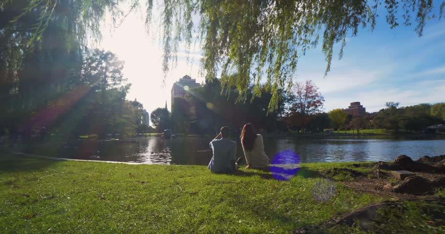 Couple Sits by Lake, Lakeside Romance in Boston Public Gardens Park