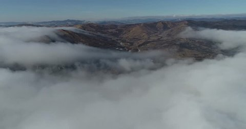 Time lapse aerial, 4k resolution, up in the sky, above in the clouds, moving speedy clouds, superb sunshine above clouds