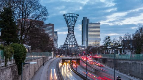 Skyscrapers munich germany hyperlapse timelapse video in 4k. Mae West is a sculpture in Munich-Bogenhausen designed by Rita McBride, munich skyline with buildings businnes dusctrict munchen.
