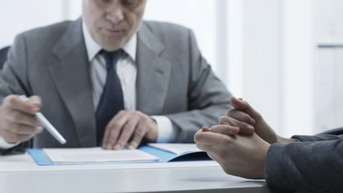 Corporate employer checking the candidate's resume during a job interview, employment and business concept