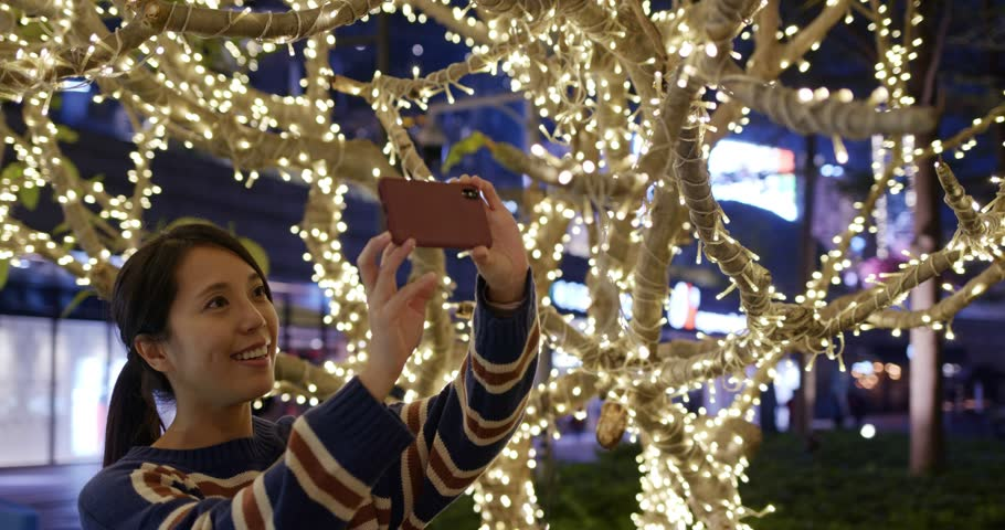 Woman take photo with cellphone of Christmas night | Shutterstock HD Video #1024154345