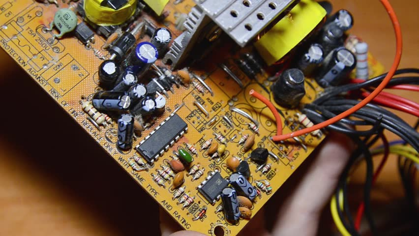 Repair of electronic devices, soldering parts. The master solders, repairs the board. solder wires | Shutterstock HD Video #1024155275