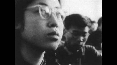 CIRCA 1960s - Chinese peasants work in vast communes under Mao Zedong's communist revolution.
