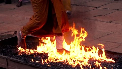 Editorial Kandy, Sri Lanka - 07.7.2016: Firewalking performance during Buddhist ceremony in Kandy, Sri Lanka, focus on feet 240fps