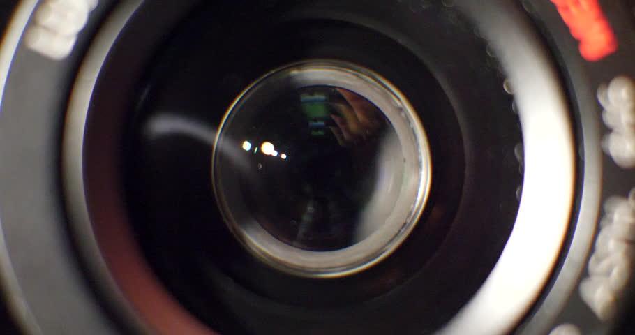 Close up macro shot of a film cinema camera lens going through its focal length and focusing.