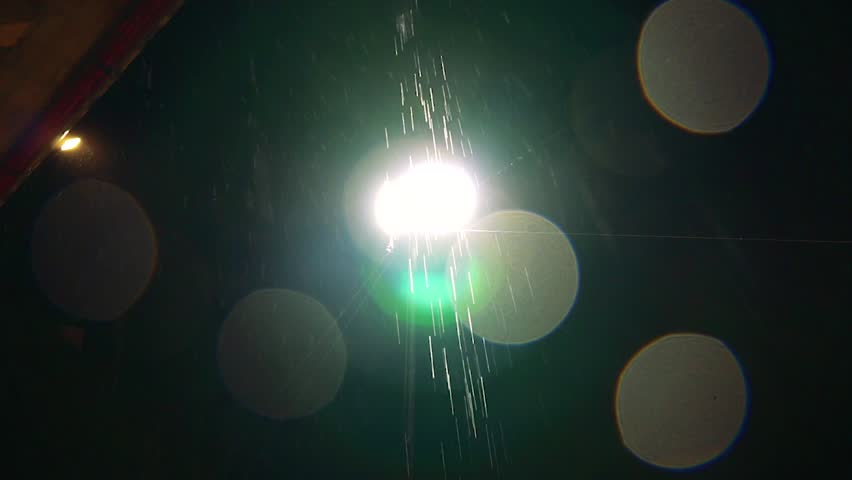 Footage of rain falling in the front of a street light.   Shutterstock HD Video #1024265195