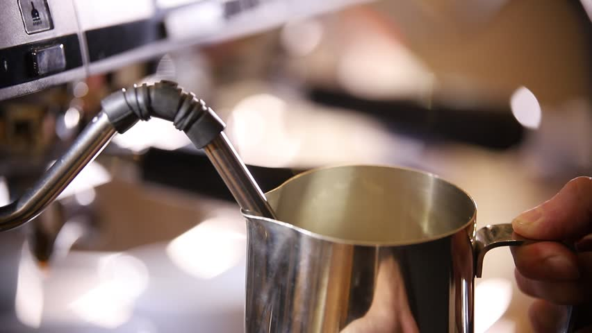 Barista making coffee. The process of milk churning for cappuccino | Shutterstock HD Video #1024303625