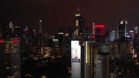 HONG KONG, HONG KONG - OCTOBER 10 2018: night time illuminated hong kong cityscape downtown aerial panorama 4k circa october 10 2018 hong kong.
