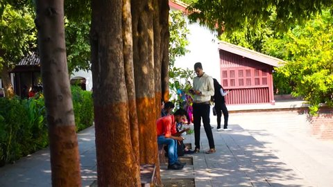Ahmedabad, Gujarat, India - Circa 2018: Visitors of the gardens of the sabarmati ashram in Gujarat India, which has multiple exhibits of how Mahatma Gandhi lived, his belongings and lifestyle. This