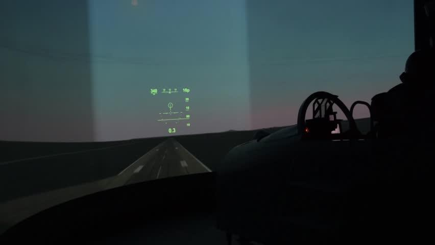 Pilot seats in a fighter jet flying simulator cockpit