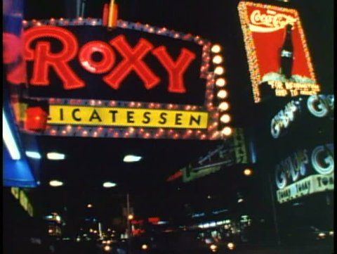 NEW YORK CITY, 1994, Times Square, Roxy sign, tilt up with Coke sign