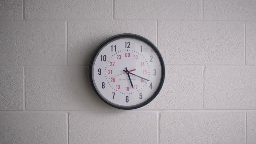Large clock in high school hallway classroom. Filmed with Arri Alexa Mini