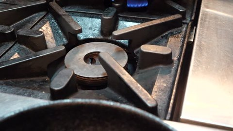 Close Up Lighting Of Gas Burner On Stove Top, Slow Motion