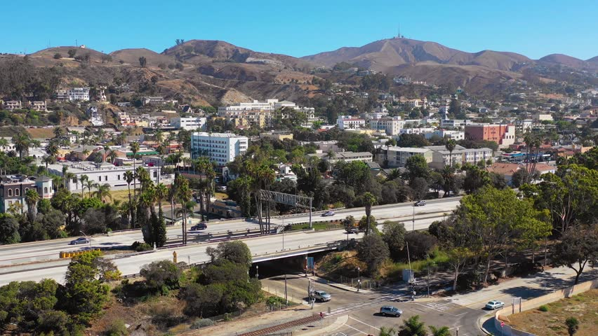 VENTURA, CALIFORNIA - CIRCA 2018 - A drone aerial of Southern California beach town of Ventura, California with freeway foreground and mountains.