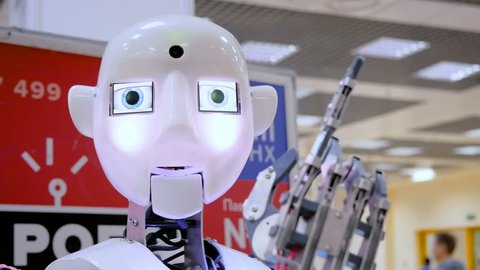 MOSCOW, RUSSIA - SEPTEMBER 8, 2017: City of Education Exhibition. White cute humanoid robot moving head and hands at technology exhibition. Future, emotion, ai and robotic concept