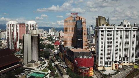 Kuala lumpur, malaysia - february 12, 2019: fly moving back around kuala  lumpur skyline near pwtc, sunway putra and hotel with bright sun and cloudy  sky