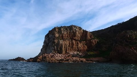 The view from a small vessel cruising out of the Knysna Heads on the Indian ocean. Captured in Knysna while on a whale watching trip in the Western Cape region of South Africa