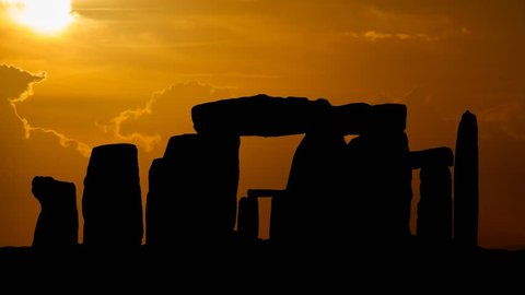 Silhouette over Stonehenge at Sunset, an ancient prehistoric monument consists of a ring of standing stones near Salisbury, Wiltshire, England, UK