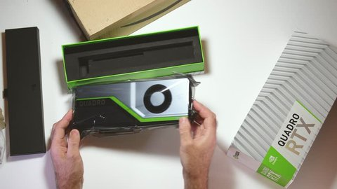 Paris, France - Feb 20, 2019: POV hands admiring the latest Nvidia Quadro RTX 5000 workstation professional video card GPU adapter unboxing